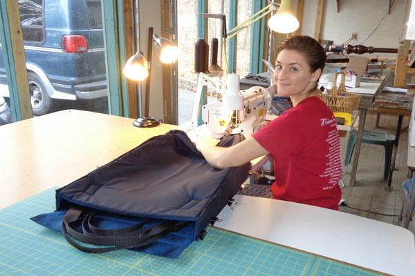 Emily sewing padded harp cases