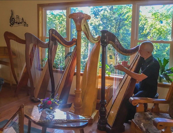 Eduard trying out our harps