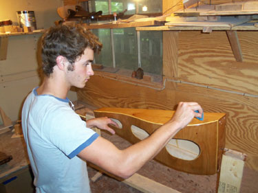 Paul putting finish on a LAP harp.